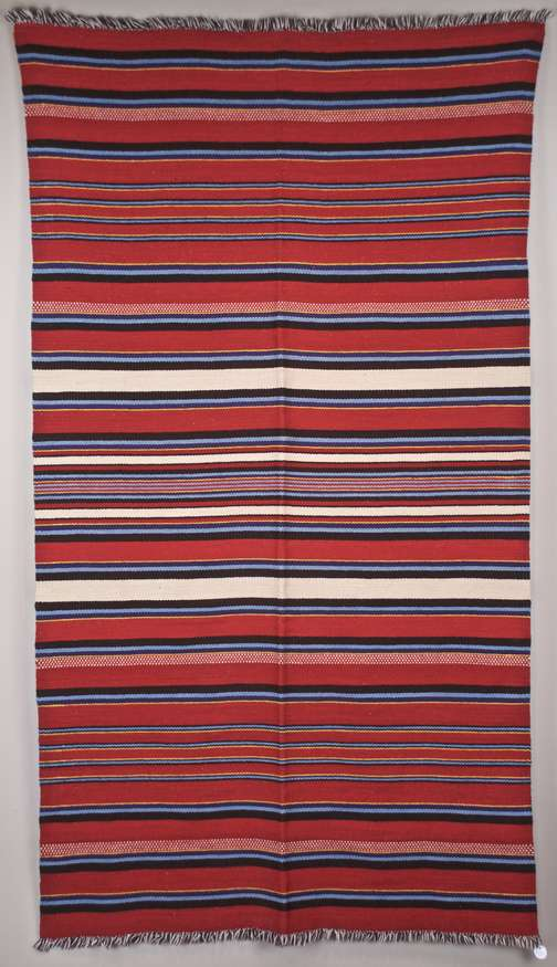 Lot 33 | Carla Bogdanoff | Rio Grande transitional blanket, 2016 | Navajo-Churro wool dyed with aniline red, indigo & chamisa | 48x84 | donated by Tres Estrellas Gallery | est. $2500-$3000
