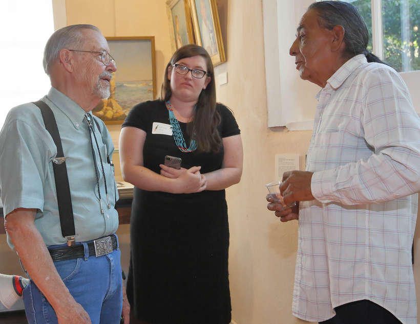 Phil Woodard, intern Chelsea Herr, and Fred Lujan, Jr. discuss the exhibition.