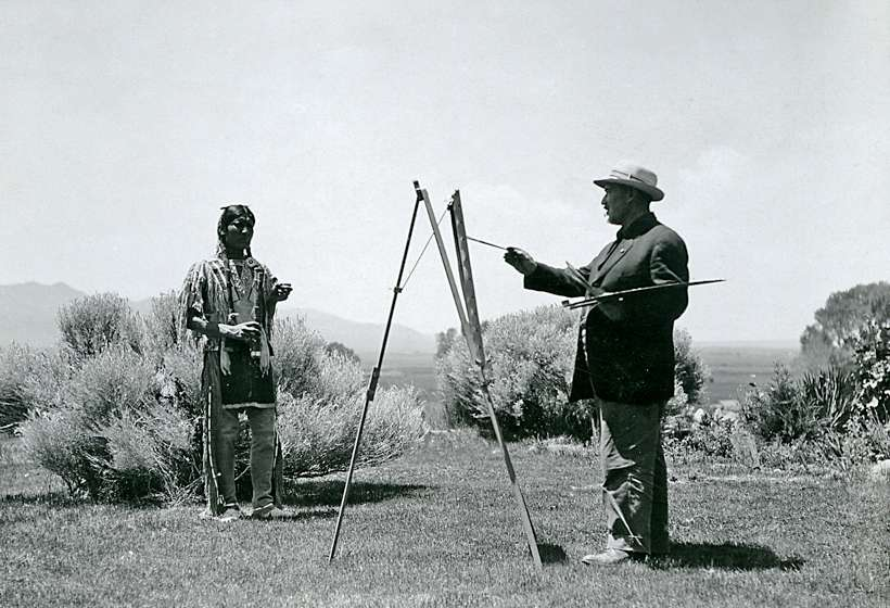 Couse painting a model in his garden, circa 1915.