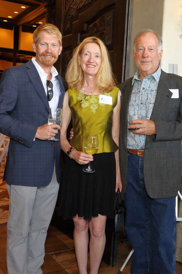 Davison Koenig, Couse-Sharp Historic Site executive director and curator, welcomes Sherry Parsons and John Rush at the Couse Foundation Fifth Biennial Gala and Art Auction.
