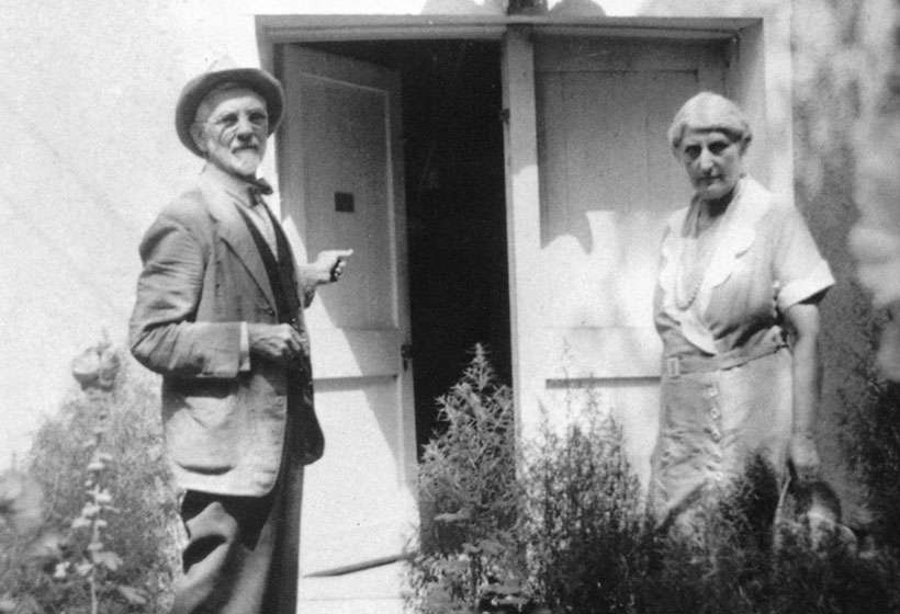 Sharp and his wife, Louise, outside his studio in Taos.