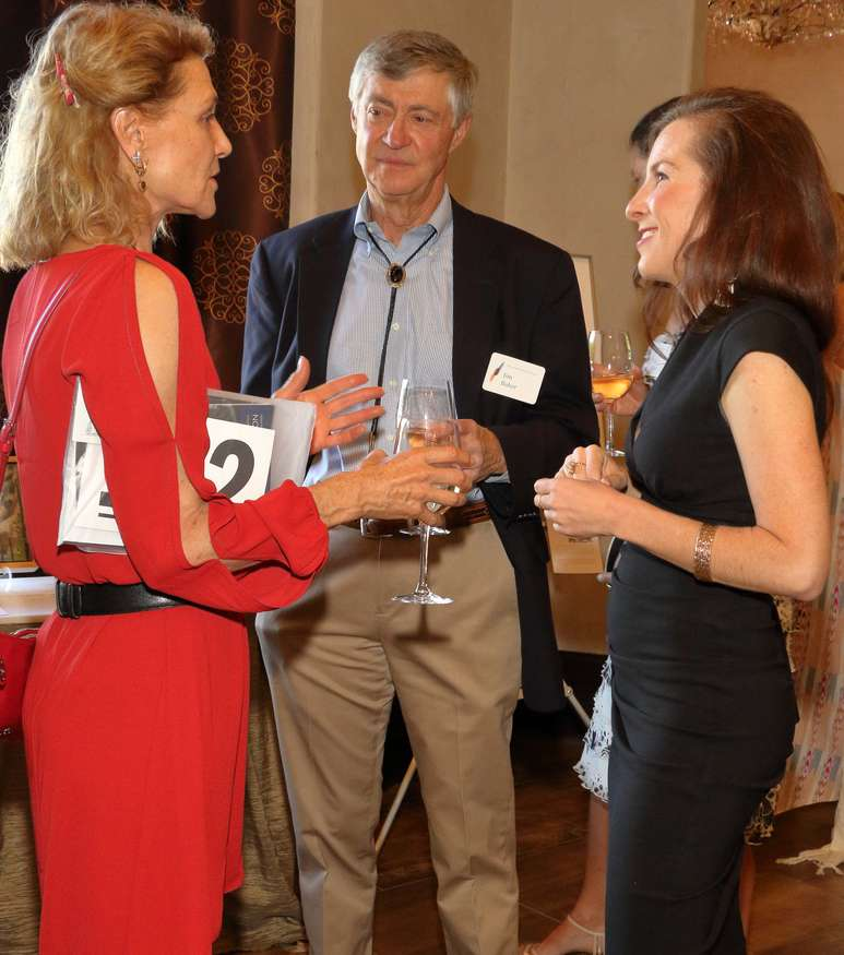Victoria Addison and Jim Baker of Addison Rowe Gallery discuss the auction with Alissa Ford, director of Western Art at Heritage Auctions.