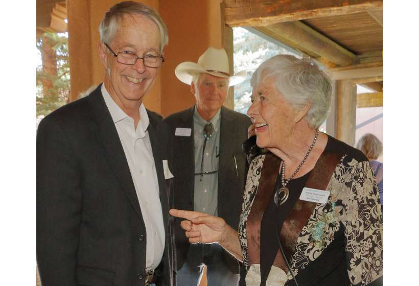 Virginia Couse Leavitt shares a laugh with auction item donor Mark Bahti.