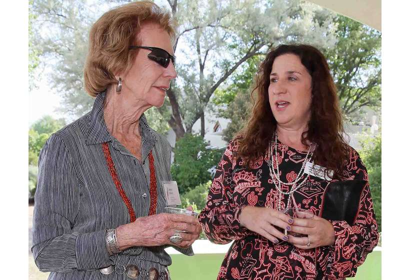 Couse-Sharp Founders Society member Adele Ward, left, enjoys the reception celebrating the 2017 opening of the restored 1915 Sharp Studio with former Board Member Abigail Hornik-Minckler.