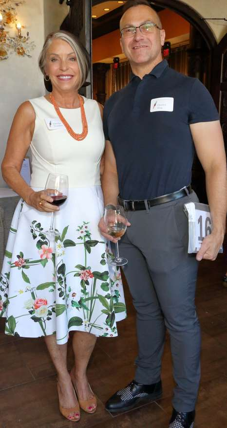 Christy Vezolles of Art Value Appraisal and auction item donor Charles King, King Galleries, enjoy the reception.