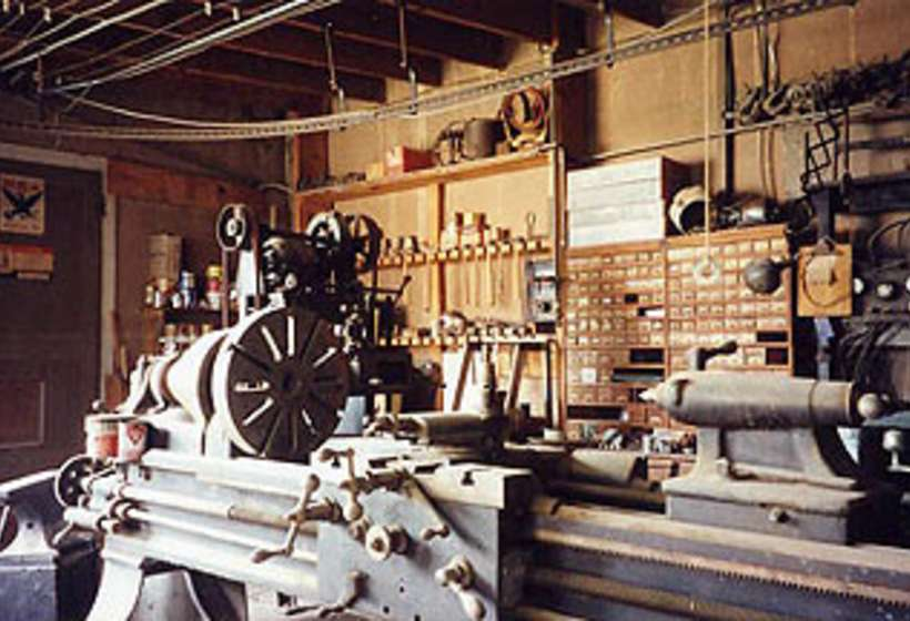 Close up of large metal lathe in Kibbey's machine shop.