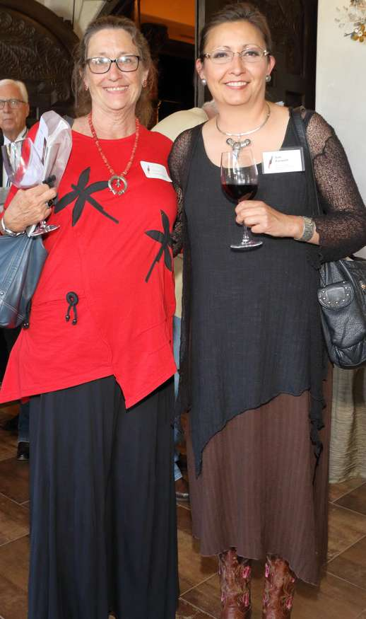 Diane Dittemore, left, Associate Curator of Ethnology at the Arizona State Museum, enjoys Gala conversation with Susan Folwell, award-winning Santa Clara potter.