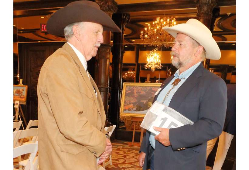 Patron Dean Snyder of Denver, left, talks art with Michael Grauer, McCasland Curator of Cowboy Culture at the National Cowboy & Western Heritage Museum.