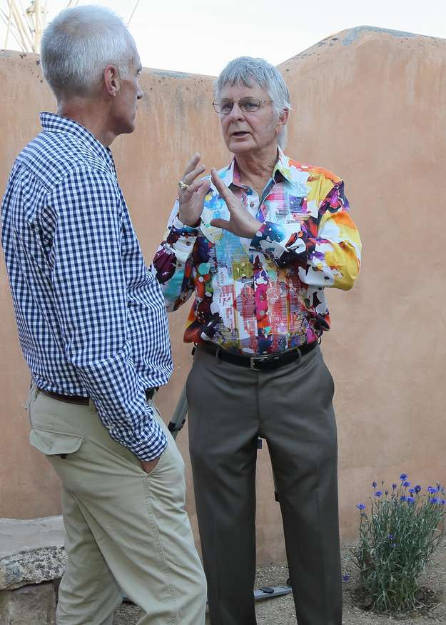 Artist Jerry Jordan, right, engages Thomas Doerk in a Sharp Studio courtyard conversation.